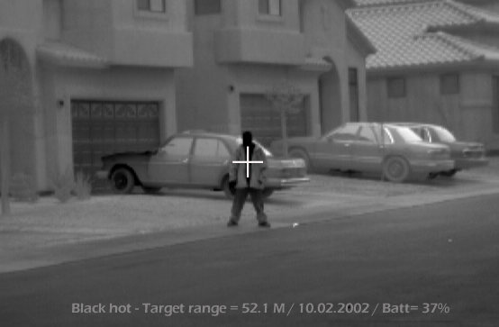 long range FLIR imager surveillance image of a man in black hot