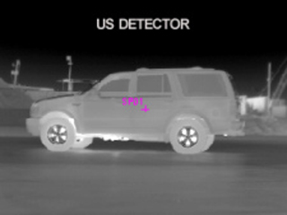 thermal image of an SUV at night