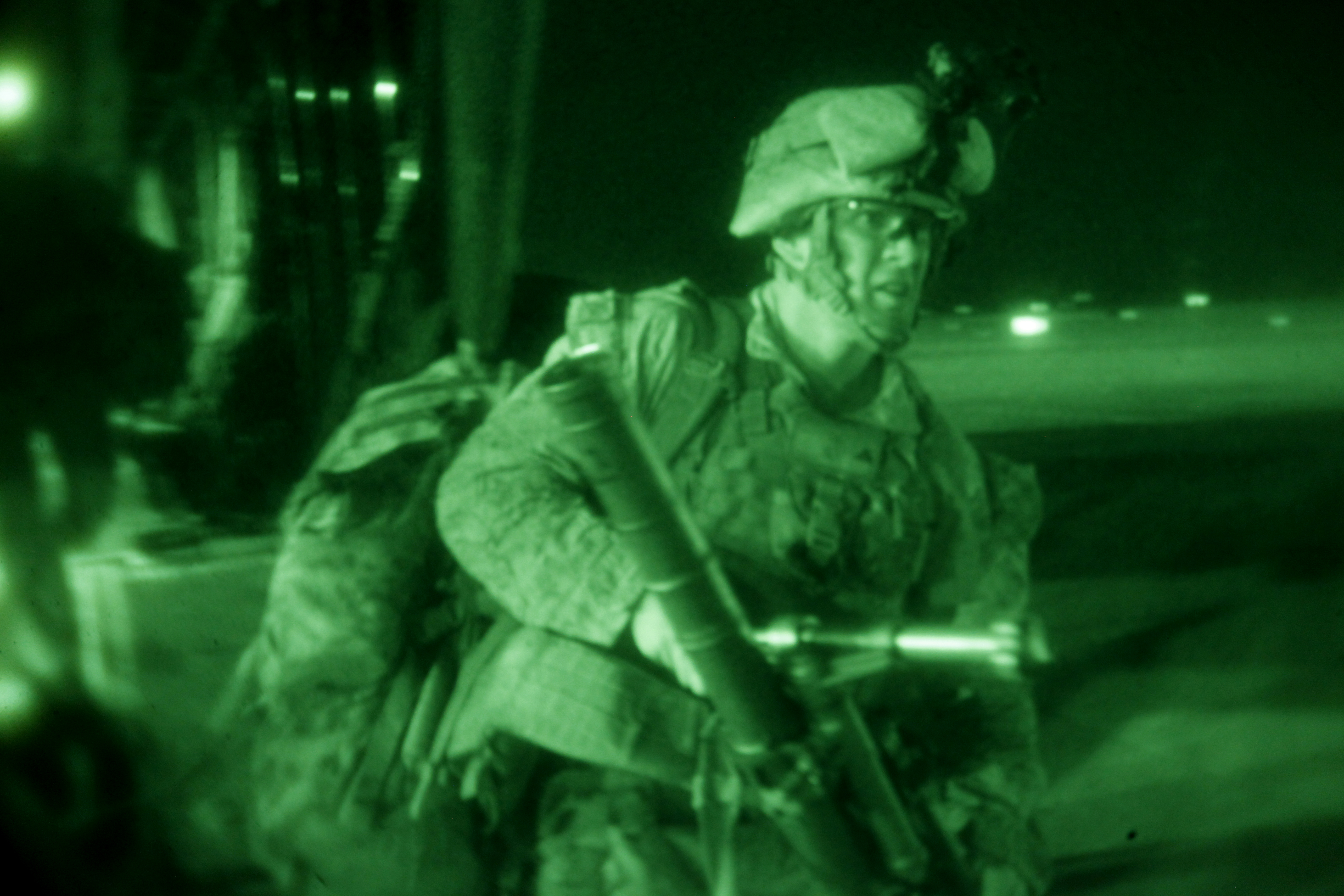 Marines in action in Iraq using night vision goggles